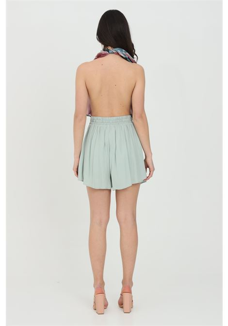 Green shorts in solid color with elastic at the back, high waist model. Wide flared bottom. Nbts NBTS | Shorts | NB21102.