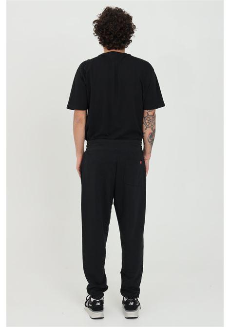 Pantaloni unisex nero new balance casual in tinta unita NEW BALANCE | Pantaloni | MP11590BK..