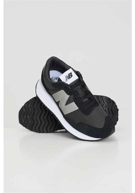 Sneakers donna nero new balance in tinta unita con logo a contrasto NEW BALANCE | Sneakers | WS237CC..