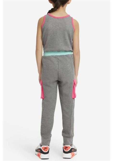 Grey jumpsuit with spring at the waist and laces. Cargo model with side pockets. Regular fit, elastic cuffs. Baby model. Brand: Nike NIKE | Suit | 36H471-GEHGEH
