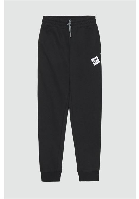 Tuta con logo frontale a vita alta NIKE | Pantaloni | 95A296-023023