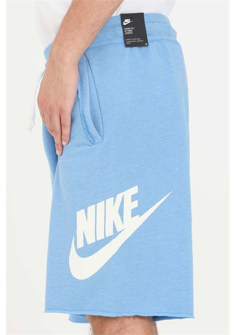 Light blue men's shorts with contrasting logo on the side nike NIKE | Shorts | AR2375462