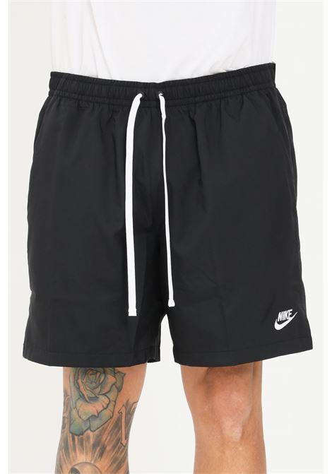 Black beach shorts with contrasting nike logo NIKE   Beachwear   AR2382010
