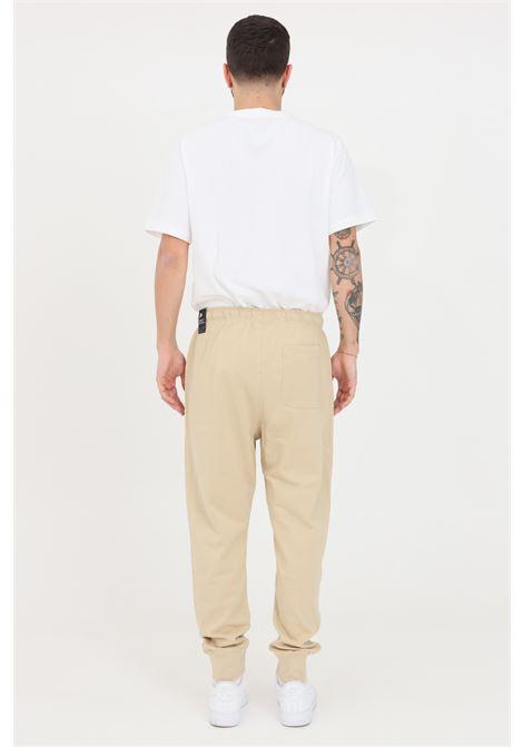 Beige sweatpants with elastic waistband. Nike NIKE | Pants | BV2762224