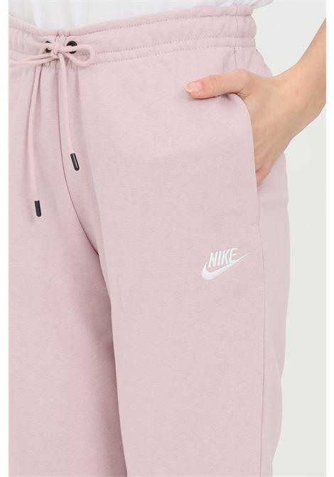 Pantaloni donna rosa champagne nike sport NIKE | Pantaloni | BV4095645