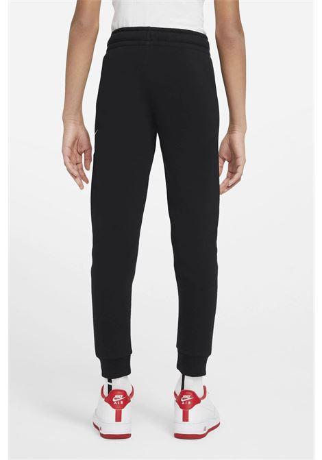 Black Sportswear Club Fleece trousers with contrasting logo on the left leg. Baby model. Brand: Nike NIKE | Pants | CJ7863016