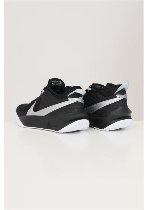 Sneakers donna bicolore nike team hustle d10 NIKE | Sneakers | CW6735004