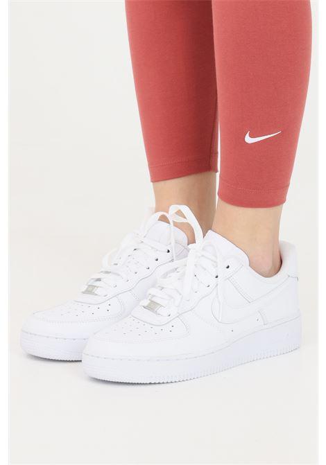 Leggings donna ruggine nike con mini logo a contrasto NIKE | Leggings | CZ8532691
