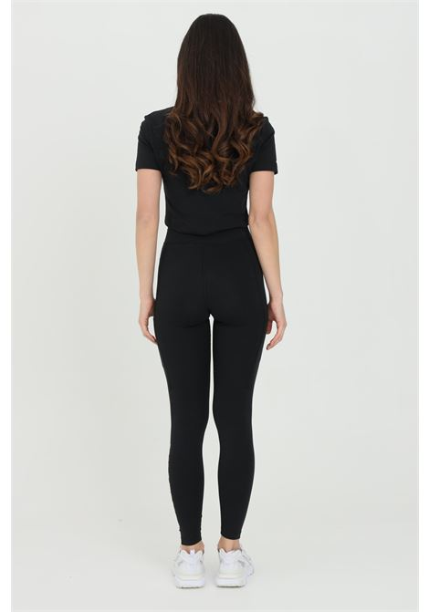 Solid color leggings with pockets on the legs and contrasting logo NIKE | Leggings | CZ8622010