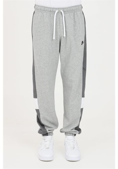 Grey trousers with contrasting bands, embroidered logo. Nike NIKE | Pants | CZ9978063