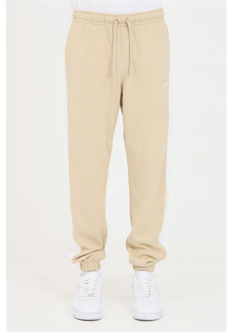 Beige trousers with contrasting bands, embroidered logo. Nike NIKE | Pants | CZ9978224