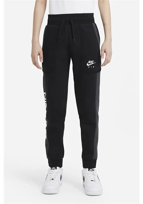 Black trousers with elastic waistband and side band in contrast with logo print. Baby model. Brand: Nike NIKE | Pants | DA0710010