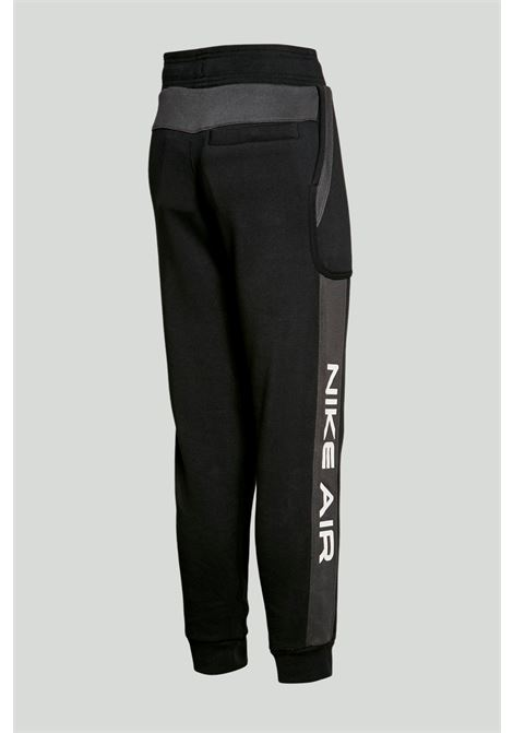 Black trousers with elastic waistband and side band in contrast with logo print. Baby model. Brand: Nike NIKE | Pants | DA0710011