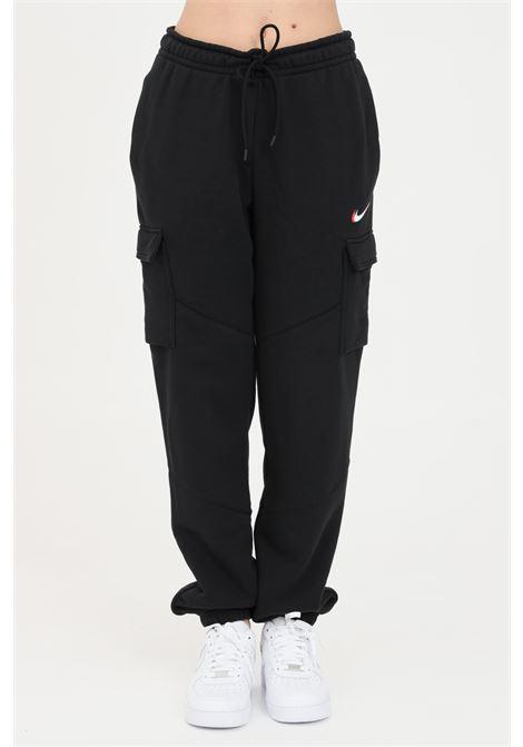 Black sweatpants with contrasting logo. Nike  NIKE | Pants | DJ4128010