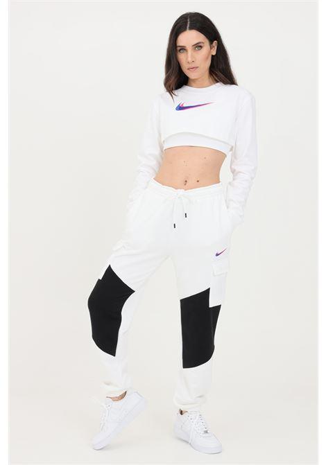 White sweatpants with contrasting logo. Nike  NIKE | Pants | DJ4128100