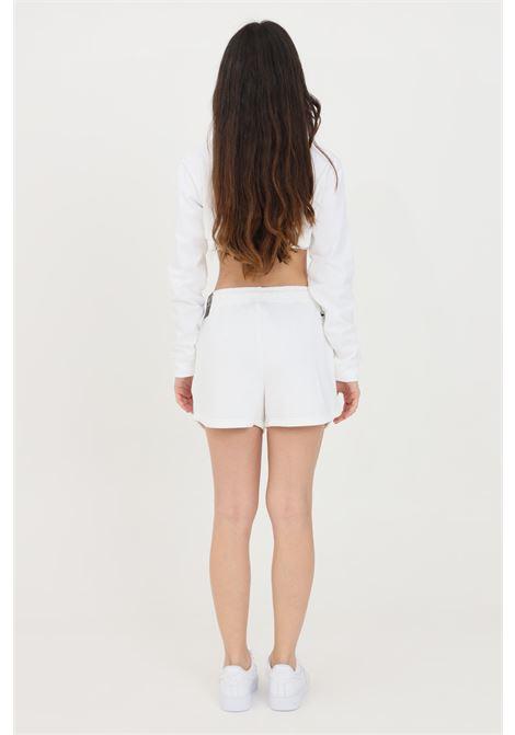 White shorts with contrasting logo. Nike  NIKE | Shorts | DJ4129100