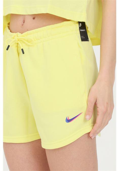 Yellow shorts with contrasting logo. Nike NIKE | Shorts | DJ4129712