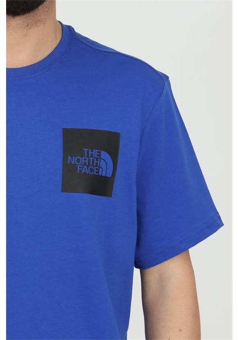 Blue t-shirt in solid color woth front logo print in contrast, short sleeve. The north face  THE NORTH FACE | T-shirt | NF00CEQ5CZ61CZ61