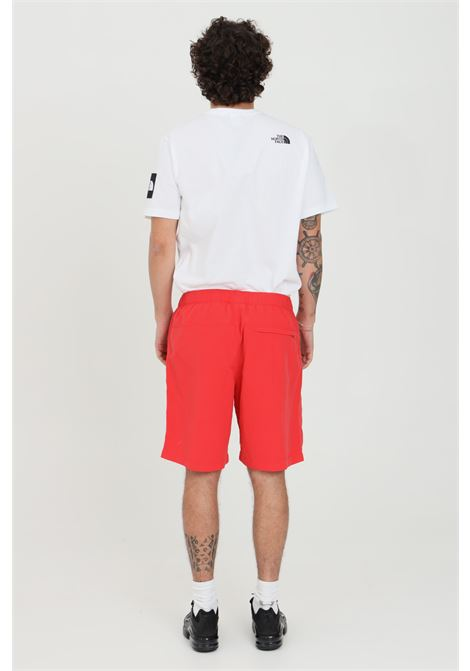 Red shorts in solid color with constrasting logo. Side pokets and back pocket with concealed button. The north face THE NORTH FACE | Shorts | NF00CMA1V331V331