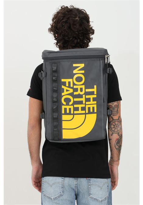 Grey backpack in solid color with yellow logo on the front, external pocket with zip and inner organizer, padded laptop compartment. The north face THE NORTH FACE | Backpack | NF0A3KVRS951S951