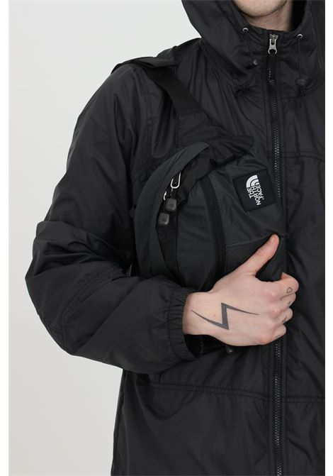 Grey-black pouch in solid color with contrasting logo on the front, adjustable belt and closure with zip. The north face THE NORTH FACE | Pouch | NF0A3KZ5MN81MN81