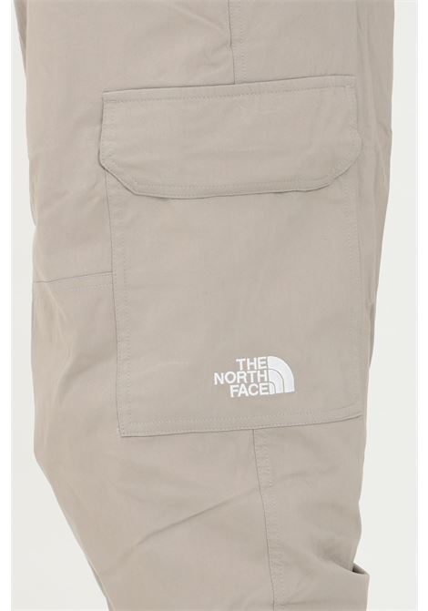 Sand cargo trousers with elastic waist, side pockets and elastic cuffs. Comfortable model. The north face  THE NORTH FACE   Pants   NF0A52ZZVQ81VQ81