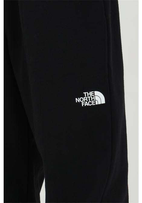 Pantaloni in felpa con molla in vita e logo laterale THE NORTH FACE | Pantaloni | NF0A5312JK31JK31