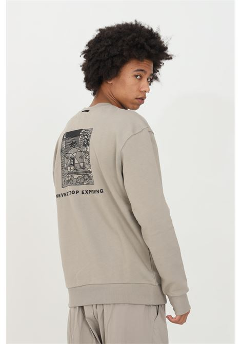 Sand sweatshirt with print on the back, small logo on the front, elastic cuffs and bottom with ribs. Over size model. The north face THE NORTH FACE | Sweatshirt | NF0A557GVQ81VQ81