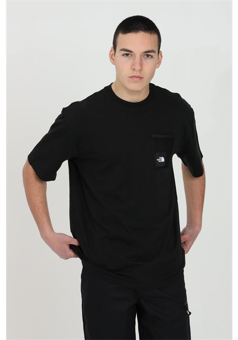 Black t-shirt with mesh patch on the front, short sleeve. Crew neck model with small logo on the back. The north face  THE NORTH FACE | T-shirt | NF0A557KJK31JK31