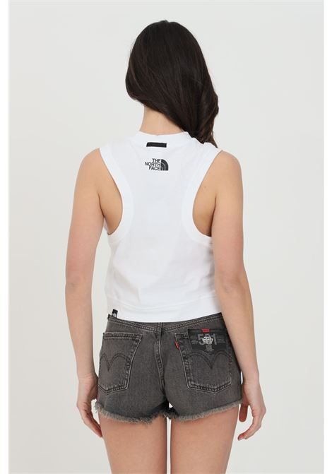 White t-shirt with contrasting logo patch on the front and logo print on the back, sleeveless model. The north face THE NORTH FACE | T-shirt | NF0A557NFN41FN41