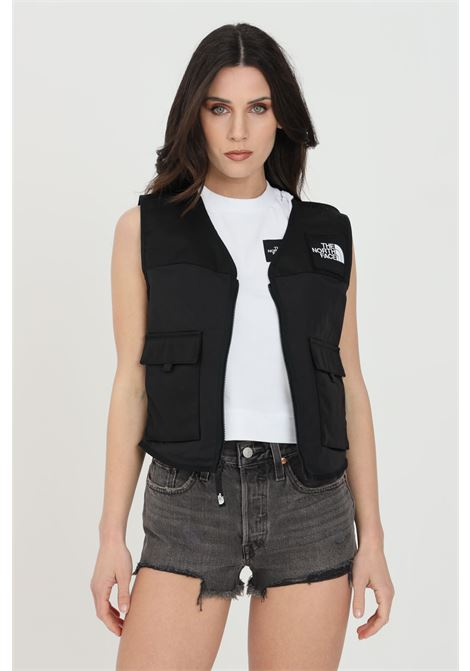 Black vest with front zip, pockets and logo patch, logo print on the back. The north face  THE NORTH FACE | Gilet | NF0A557QJK31JK31