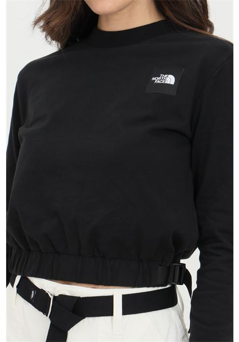 Black sweatshirt in solid color with contrasting logo patch on the front, short cut and drawstring. The north face  THE NORTH FACE | Sweatshirt | NF0A557SJK31JK31