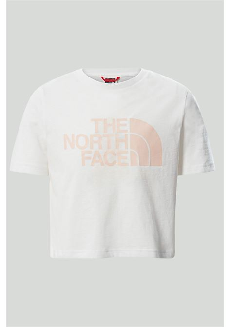 White t-shirt in solid color with pink logo on the front, short cut. Baby model. Brand: The north face THE NORTH FACE | T-shirt | NF0A558XFN41FN41