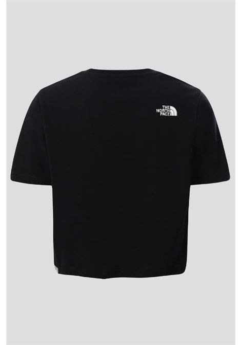 Black t-shirt in solid color with white logo on the front, short cut. Baby model. Brand: The north face THE NORTH FACE | T-shirt | NF0A558XJK31JK31