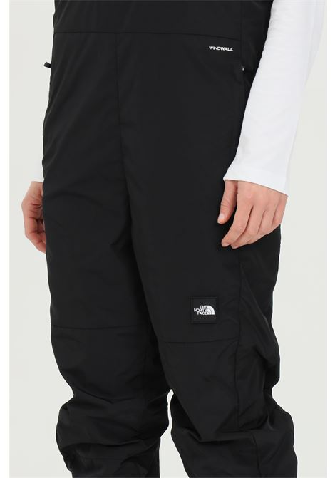 Black salopette in solid color with contrasting logo, adjustabe braces. The north face THE NORTH FACE | Suit | NF0A55AVJK31JK31