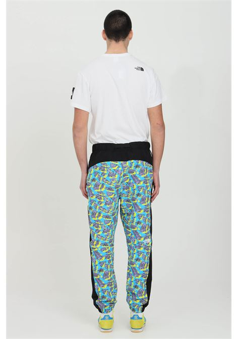 Multicolor trousers with elastic waistband, side pockets with zip and elastic cuffs. The north face   THE NORTH FACE | Pants | NF0A55BG05B105B1