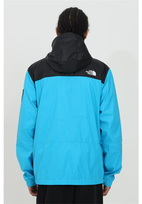Light blue-black wind jacket with zip, side logo patch and hood. The north face  THE NORTH FACE | Jacket | NF0A55BRD7R1D7R1