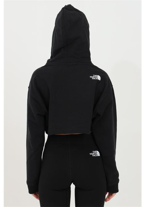 Black coordinates hoodie in solid color with contrasting print on the front, short cut. The north face THE NORTH FACE | Sweatshirt | NF0A55UYJK31JK31