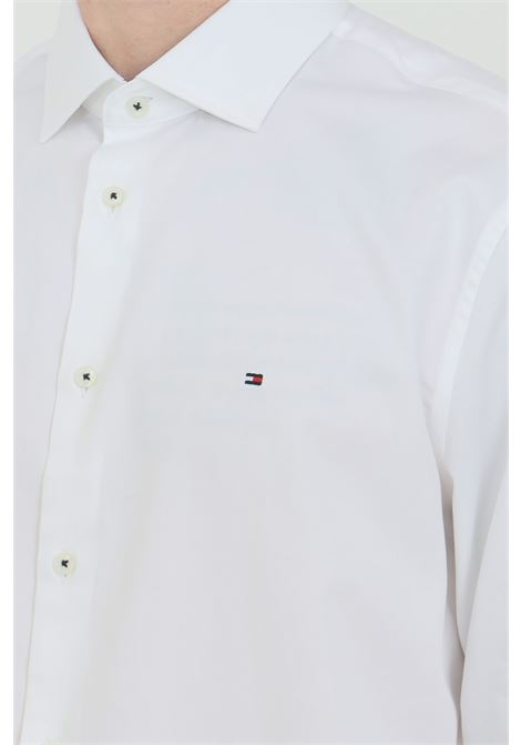 White shirt in solid color, classic closure with front buttons. Slim fit model. Tommy hilfiger TOMMY HILFIGER | Shirt | MW0MW16489YBR