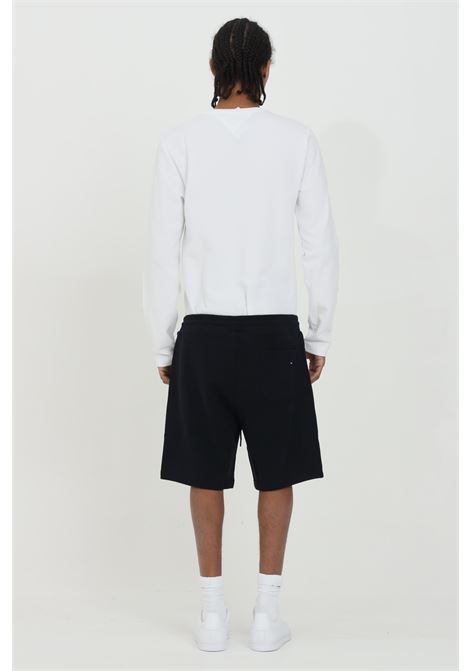 Blue shorts with side pockets and embroidery. Elastic waistband with laces. Tommy hilfiger  TOMMY HILFIGER | Shorts | MW0MW17401DW5