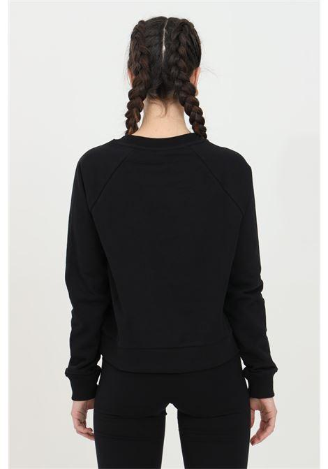 Felpa donna nero vans girocollo in tinta unita con logo frontale a contrasto, fondo e polsini elastici. Modello comodo VANS | Felpe | VN0A47THBLK1BLK1