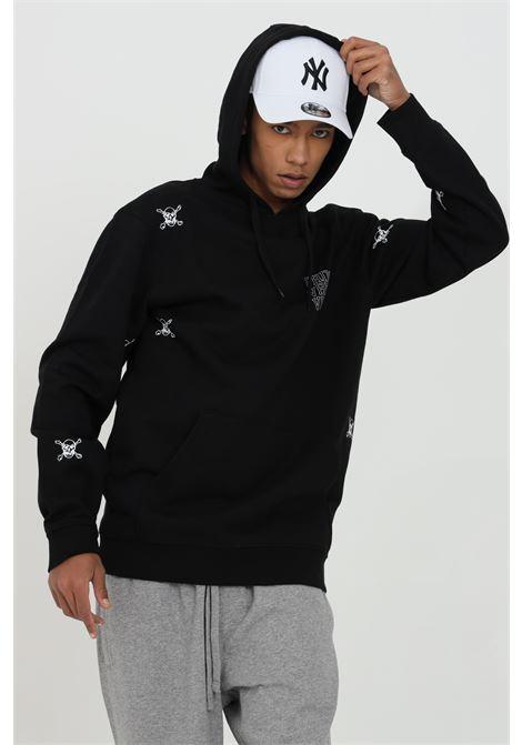 Black Varsity Hoodie with allover skull print and back lettering print, maxi pocket on the front. Vans VANS | Sweatshirt | VN0A54AFBLK1BLK1