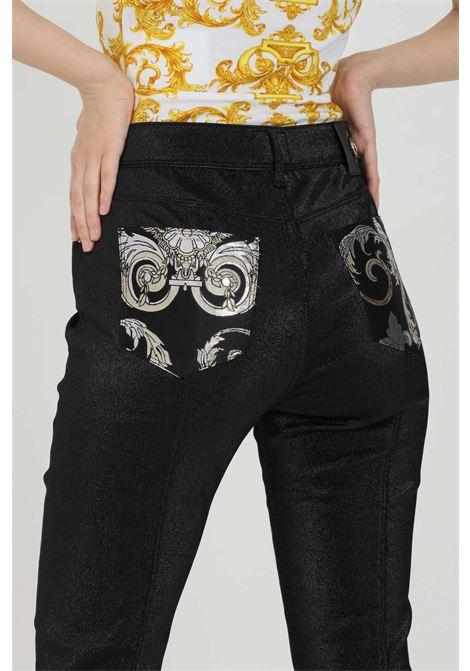 Black trousers with glitter, skinny model. Brand: Versace Jeans Couture  VERSACE JEANS COUTURE | Pants | A1HWA0X015644899