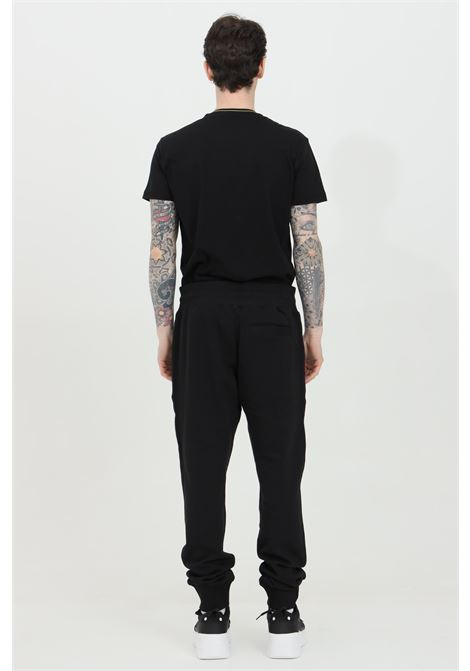 Black trousers with spring at the waist and laces. Large adjustable belt with drawstring. Two pockets on the sides. Brand: Versace Jeans Couture VERSACE JEANS COUTURE | Pants | A2GWA13F30453K42