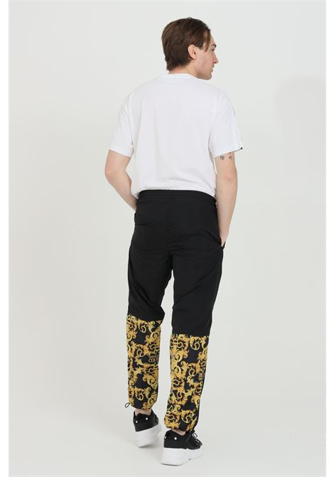 Casual trousers in shiny fabric VERSACE JEANS COUTURE | Pants | A2GWA1C225128899