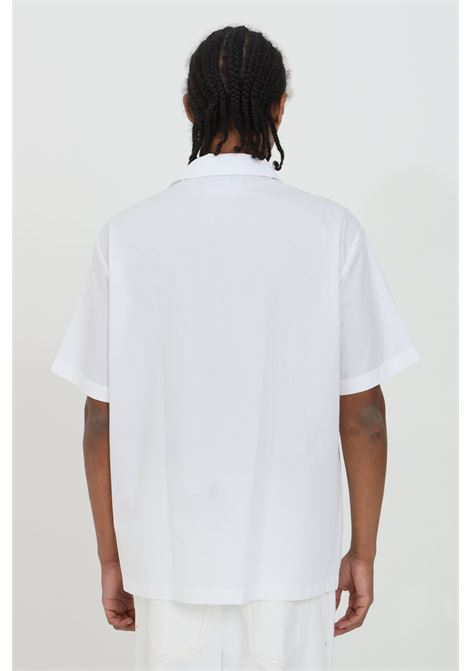 White shirt in solid color with short sleeves and front application. Pointed collar, tone-on-tone seams, front closure with buttons. Brand: Versace Jeans Couture VERSACE JEANS COUTURE | Shirt | B1GWA6B330422003