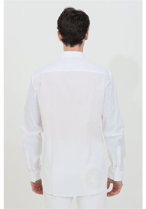 White shirt with contrasting logo on the chest, front closure with buttons, classic collar, long sleeves and tight cuffs. Brand: Versace Jeans Couture VERSACE JEANS COUTURE | Shirt | B1GWA6S530421003