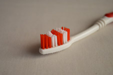 185-red-toothbrush-closeup - Public Domain Pictures
