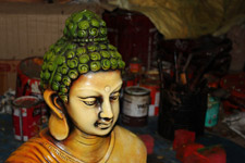 Buddha Idol With Workshop Background - Public Domain Pictures