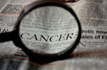 Cancer Word Magnified In Newspaper - Public Domain Pictures
